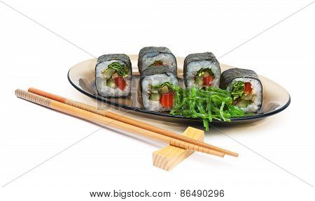 Rolls With Cucumber And Pepper On A Plate On A White Background