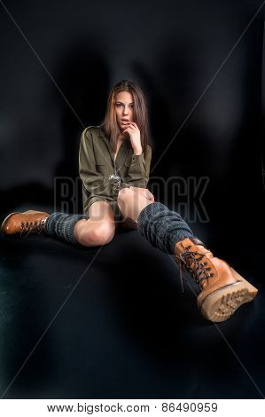 Portrait of young pretty woman in boots