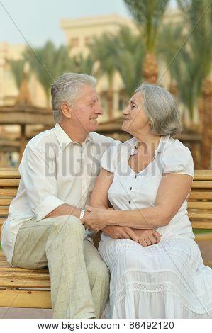 Senior couple sitting o