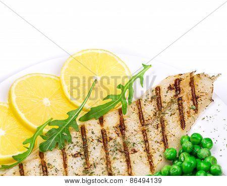 Grilled fish fillet.