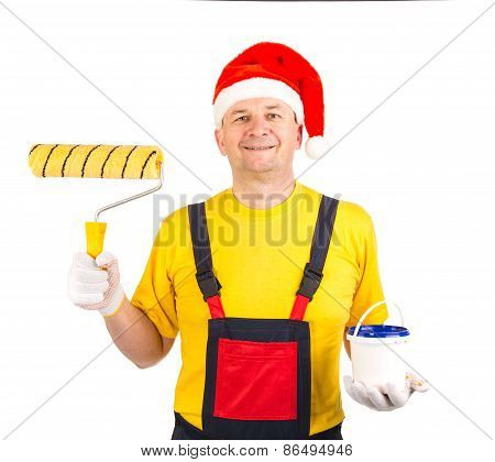 Worker in santa hat with roller.