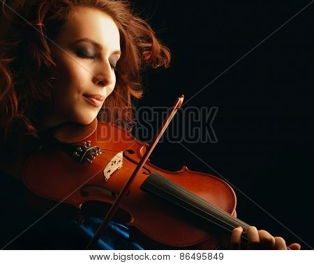 Violin playing violinist musician. Woman classical musical instrument player on black