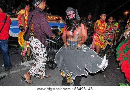 Man with mask and pig, Yogyakarta city festival parade