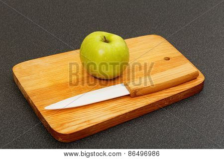 Small Green Apple And Knife