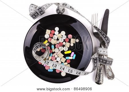 Pills And Measuring Tape