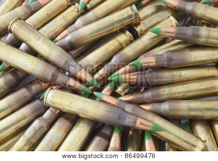 Pile Of Cartidges With Green Tipped Bullets