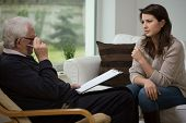 stock photo of psychologist  - Young woman talking with her older psychologist - JPG