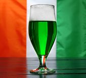 picture of irish flag  - Glass of green beer on Ireland flag background - JPG