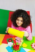 stock photo of ten years old  - Ten Year Old Girl with Decorations and Colorful Paper. ** Note: Visible grain at 100%, best at smaller sizes - JPG