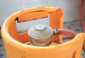 picture of cylinder  - closeup of yellow gas cylinder in kitchen - JPG
