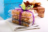 stock photo of crispy rice  - Puffed rice crispy bars wrapped as edible gift - JPG
