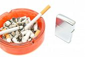 image of cigarette lighter  - two cigarettes and lighter on white closeup - JPG