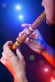 pic of soffit  - Folk musician in concert plays the melody on the Ethnic Flute - JPG