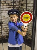 foto of policeman  - Policeman boy holding a sign for stop - JPG