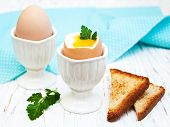 pic of boil  - boiled eggs for breakfast on a old wooden table - JPG