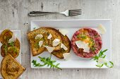 pic of tartar  - Beef tartar and toast bread with garlic sprinkled with parmesan shavings and microgreens - JPG
