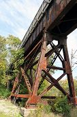 stock photo of trestle bridge  - Close up image of an old rusted train tressel and bridge - JPG