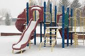 picture of snow-slide  - Playset in winter snow falling and no children to play - JPG