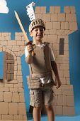 image of berserk  - photo of the boy in medieval knight costume made of cardboard - JPG
