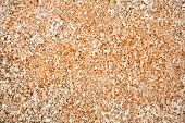 stock photo of wood craft  - Pile of wood sawdust for background or texture - JPG