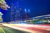 picture of traffic light  - Traffic lights on the street of Abu Dhabi at night - JPG
