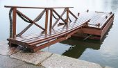 picture of pier a lake  - Shining wet wooden floating pier in still lake water Finland - JPG