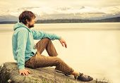 pic of scandinavian  - Man Traveler relaxing alone outdoor Lifestyle Travel concept scandinavian mountains nature on background  - JPG