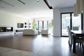 stock photo of enormous  - Photo of spacious house with enormous bright lounge - JPG