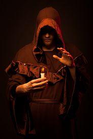 stock photo of sorcerer  - Portrait of mystery unrecognizable monk in robe - JPG