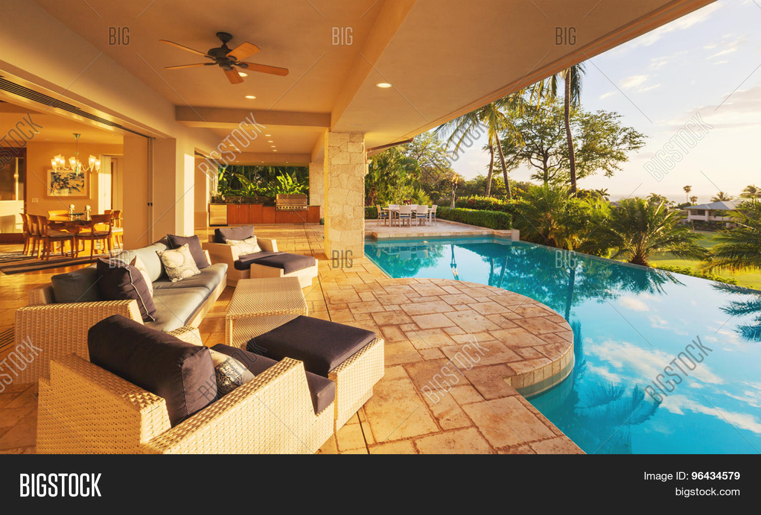 Beautiful luxury home with swimming pool at sunset stock for Luxury swimming pools