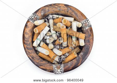 Butt Cigarettes In Wooden Ashtray
