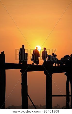 Monks at sunset on the U Bein Bridge
