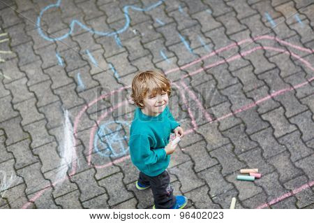 Little Blond Boy Painting With Colorful Chalks Outdoors