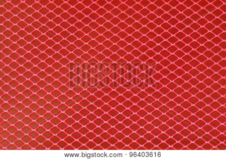 Background of red steel grating. Metallic background.