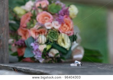 Wedding Rings On A Wooden Board