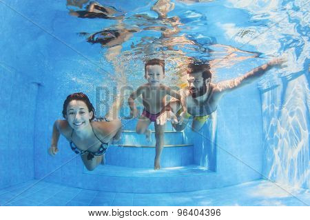 Happy Family With Children Swimming With Fun In Pool