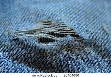 Frayed and torn denim texture. Jeans texture.