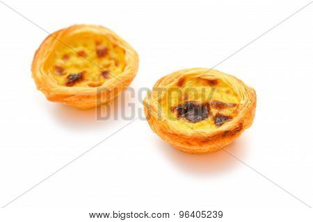 Two Single Portuguese Egg Tarts On A White Background