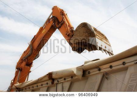 Excavator Loads Sand