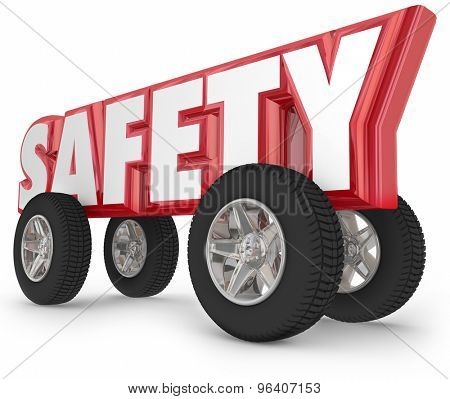 Safety driving word with wheels or tires to illustrate safe traveling in car, automobile, truck or other vehicle on the road