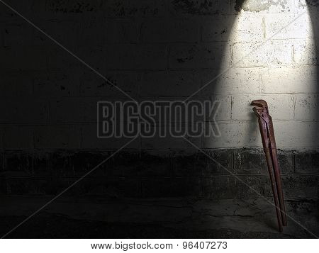 Old Adjustable Wrench Standing At Stone Wall
