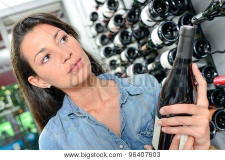 Brunette in a wine shop