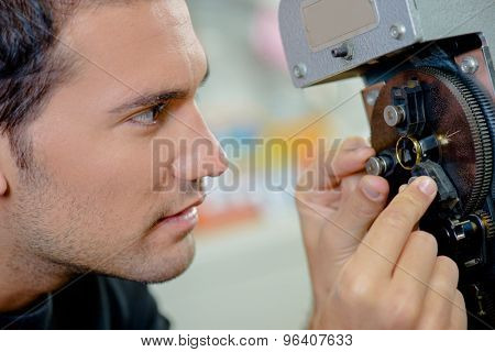 Man adjusting dial