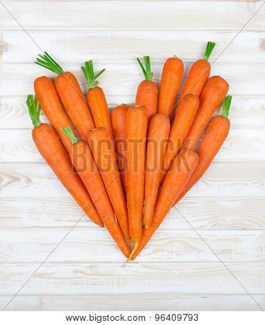 The Heart Of The Carrot On A Wood Background