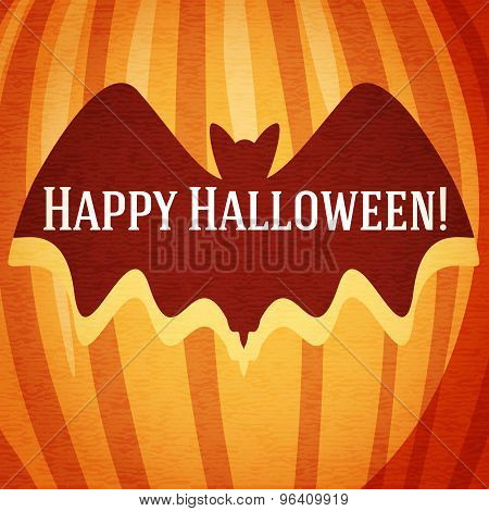 Happy halloween greeting card with bat carved in pumpkin.