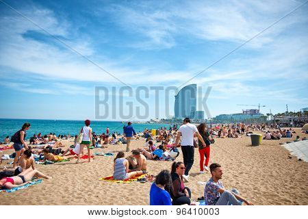 BARCELONA, SPAIN - MAY 02: Barceloneta Beach against W Barcelona Hotel in May 02, 2015 in Barcelona, Spain. Barceloneta Beach - one of the most popular in the city