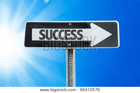 Success direction sign with a beautiful day