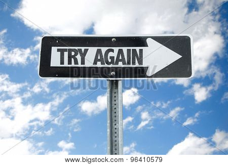 Try Again direction sign with sky background