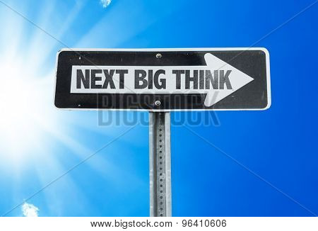 Next Big Think direction sign with a beautiful day