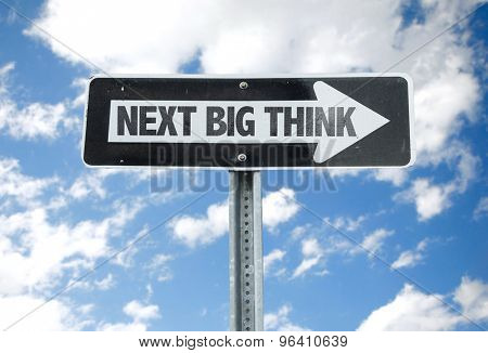 Next Big Think direction sign with sky background